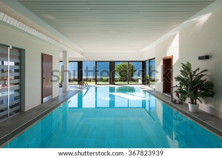 Architecture, house with garden, Indoor swimming pool - stock photo