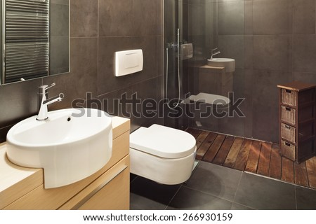 Architecture, modern house, dark bathroom - stock photo