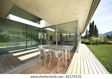 Architecture, modern house outdoors, veranda - stock photo