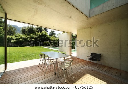 Architecture, modern house outdoors, veranda - stock photo