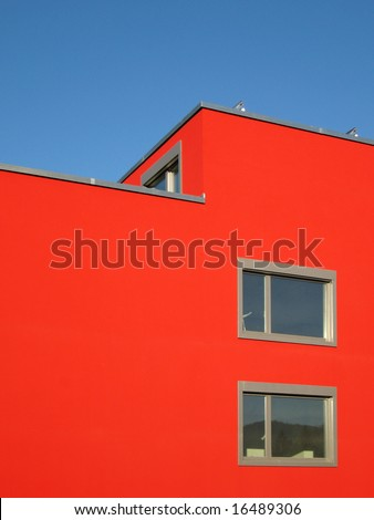 Architecture - Modern red building on a bright blue sky - stock photo