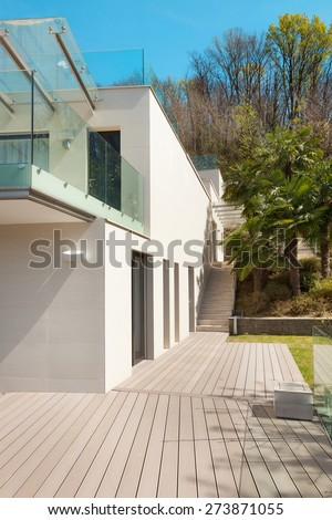 architecture, modern white house, view from the patio, outdoor - stock photo