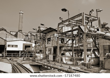Architecture of industrial factory exterior with buildings and smokestack. - stock photo