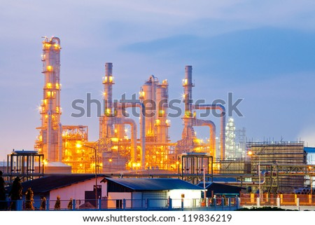 Architecture of Oil Refinery Plant with distillation tower with Sunrise Twilight - stock photo