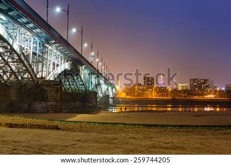 Architecture of Poniatowski bridge over Vistula river in Warsaw, Poland - stock photo