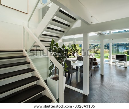 Architecture, open space of a modern house,  living room view from stair - stock photo
