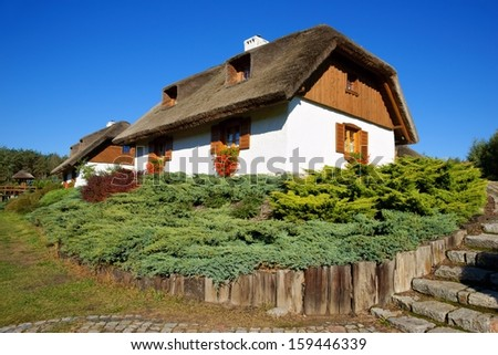 Architecture, renovated old Polish huts, thatched roof - stock photo