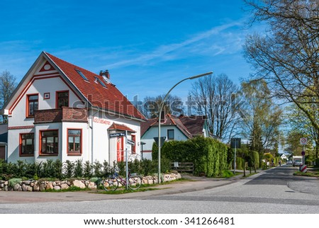 Architecture residential building, traditional house against blu sky background.  Typical German neighbourhood in Hamburg district, old house formerly Kolonialwaren store, grocery shop - stock photo