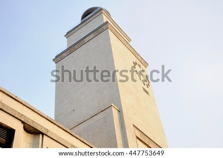 Architecture 30's facade detail with clock tower. Brescia,  Italy. - stock photo