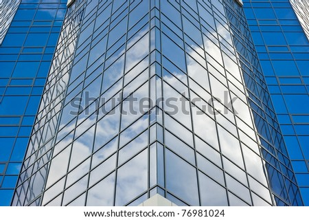 architecture.surface of glass building with the reflection of clouds - stock photo