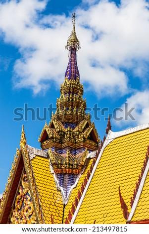 architecture top part of  thai temple roof on blue sky background    - stock photo