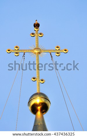 Architecture view - the cross of Saint Sophia Orthodox Cathedral in Veliky Novgorod, Russia with a sitting metallic dove symbolizing the Holy Spirit. It is the oldest Orthodox church in Russia. - stock photo