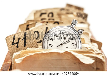 Archive file folders in drawer with stopwatch
