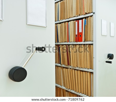 Archive Interior. Modern mobile cabinet with documents folder - stock photo