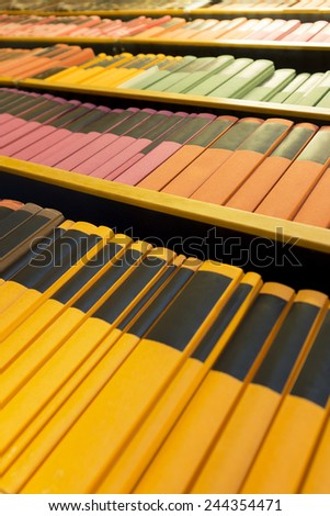 Archive with books in various colors