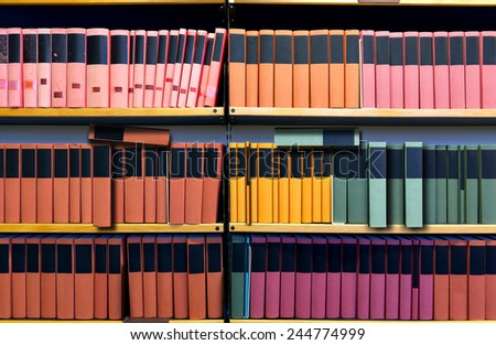 Archive with many binders on shelf - stock photo