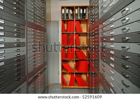 Archives in the basement with drawings and microfilms - stock photo