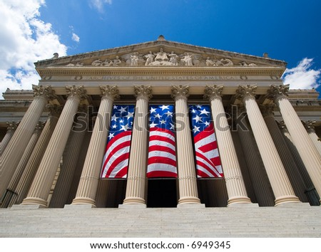 Archives of the United States of America in Washington DC, with American flag - stock photo