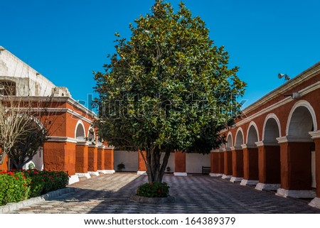 archs and columns in Santa Catalina monastery in the peruvian Andes at Arequipa Peru - stock photo