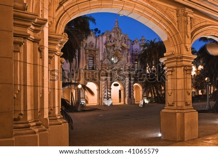 Archway and ornate building at night - stock photo