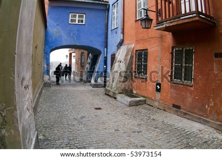 Archway at tenement house at Warsaw's old town. - stock photo