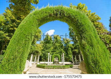 Archway in Aranjuez royal palace gardens, Spain. - stock photo