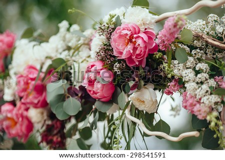 archway of many beautiful flowers, wedding arch with peonies - stock photo