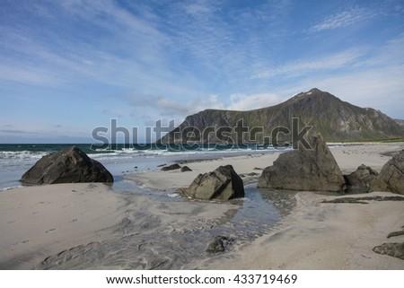 Arctic beach with stones - stock photo