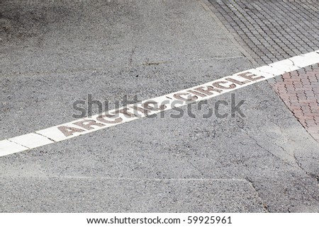 Arctic circle marking on the pavement. Christmas land, Rovaniemi Finland. - stock photo