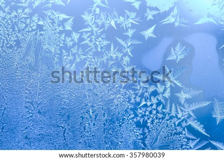 Arctic concept. Ice pattern on a window in winter time. frozen window macro view - stock photo