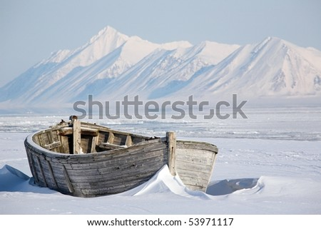 Arctic, frozen old wooden boat
