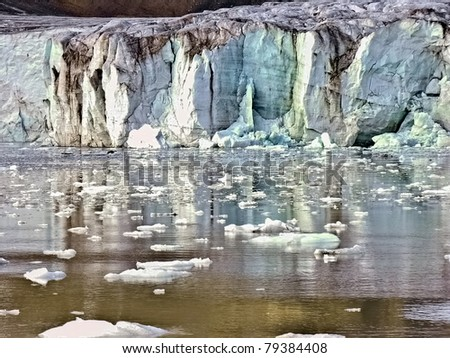 Arctic Glacier in Svalbard melting into water - stock photo