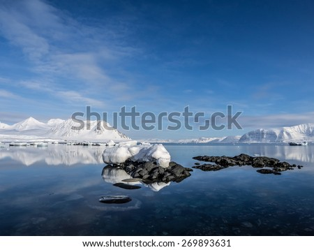Arctic landscape - ice, sea, mountains, glaciers - Spitsbergen, Svalbard - stock photo