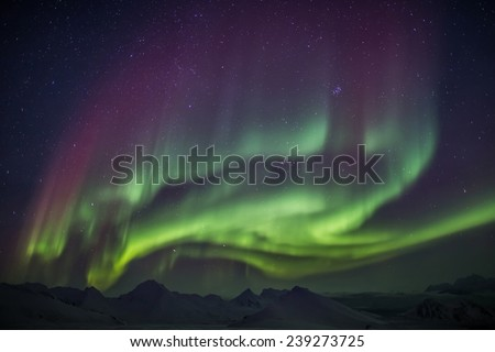Arctic landscape with Northern Lights - Spitsbergen, Svalbard - stock photo
