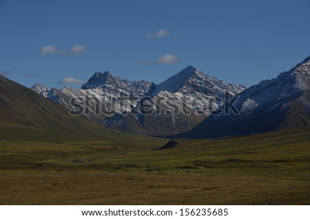 Arctic Valley with Snowy Mountains - stock photo