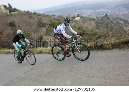 "ARDECHE, FRANCE - FEB 24: Guillaume Bonnafond and Julien El Fares riding ""LES BOUCLES DU SUD ARDECHE"" UCI Europ Tour. Matthieu Drujon won the race on February 24, 2013 in Sampzon Rock Ardeche, France. - stock photo"