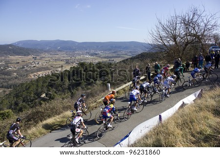 "ARDECHE, FRANCE - FEB 26: Professional racing cyclists riding UCI Europ TOUR ""LES BOUCLES DU SUD ARDECHE"". Remi Pauriol wins the race on February 26, 2012 in Sampzon Rock, Ardeche, France. - stock photo"