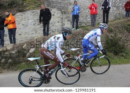 "ARDECHE, FRANCE - FEB 24: Thibaut Pinot and Hubert Dupont riding ""LES BOUCLES DU SUD ARDECHE"" UCI Europ Tour. Matthieu Drujon won the race on February 24, 2013 in Sampzon Rock, Ardeche, France. - stock photo"