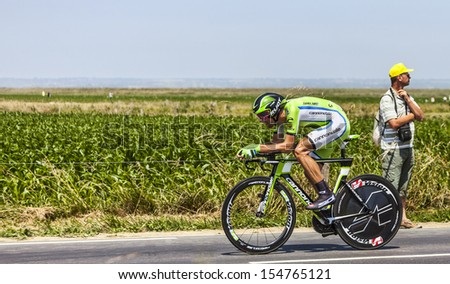 ARDEVON,FRANCE-JUL 10:The Slovenian cyclist Kristijan Koren from Cannondale Team cycling during the stage 11(time trial Avranches -Mont Saint Michel) of Le Tour de France on July 10, 2013
