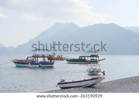 are strolling boats near Cirali beach, Turkish Riviera - stock photo