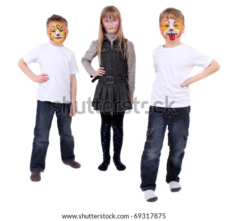 are two boys and one girl with drawings of faces - stock photo