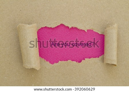 Are you covered? question written under torn paper. - stock photo