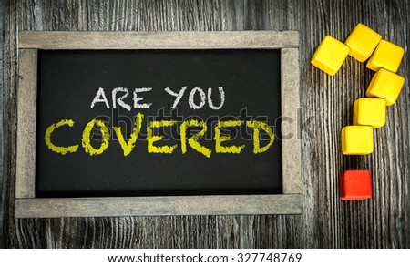 Are You Covered? written on chalkboard - stock photo