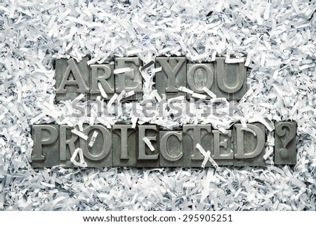 are you protected question made from metallic letterpress type inside of shredded paper heap - stock photo