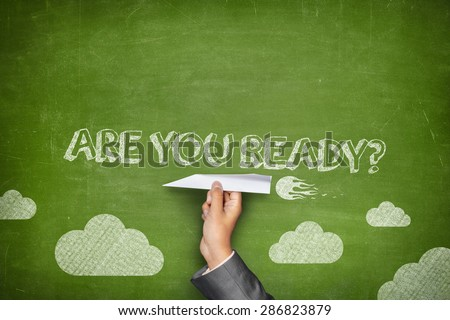 Are you ready concept on green blackboard with businessman hand holding paper plane - stock photo