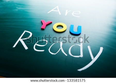 Are you ready? conceptual words on blackboard - stock photo