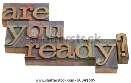 Are you ready question - vintage wooden letterpress printing blocks, stained by color inks, isolated on white - stock photo