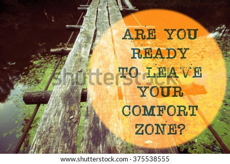 are you ready to leave your comfort zone question written on wooden rope bridge landscape - stock photo