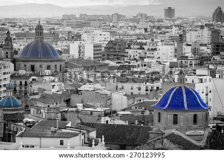 Areal view, as seen from the miguelete, on the streets in Valencia, blue domes of ancient churches typical for this old european spanish city - stock photo