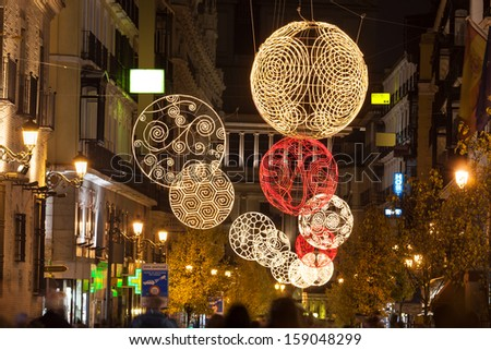 Arenal street of Madrid illuminated for christmas, near the Puerta del Sol , the Opera building as background - stock photo